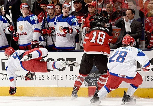Jake Virtanen sends a player flying in last January's World Junior gold medal game, which Canada won 5-4 over Russia.