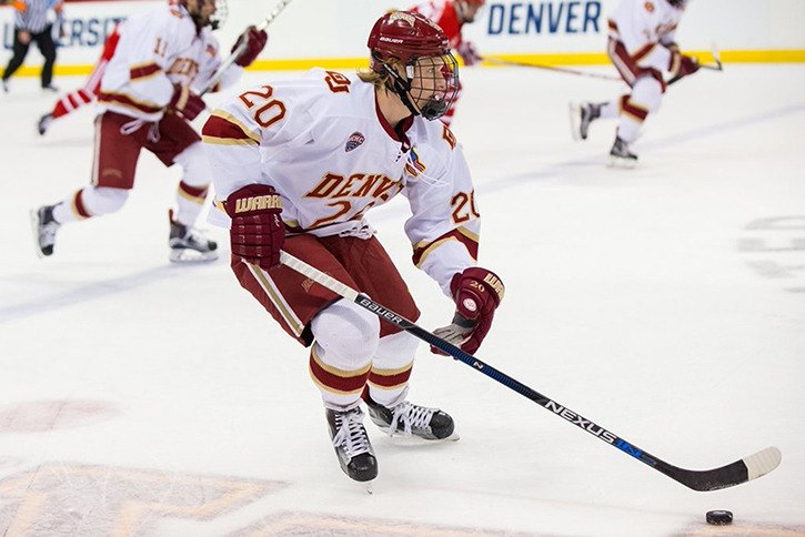 Langley's Danton Heinen is leaving the University of Denver after two seasons to turn pro, inking a three-year NHL entry level contract with the Boston Bruins.