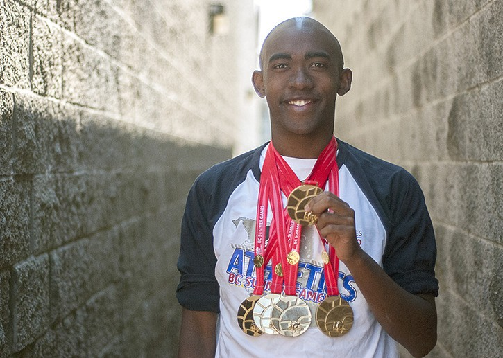 Twenty-year-old Michael Savage from Langley proudly shows off his five gold medals from the July 17 to 20 B.C. Summer Games in Nanaimo. Savage won gold in the 100m, 200m, 400m, 800m and 4x100m relay events in the Special Olympics division of the games. He also placed fourth in long jump.