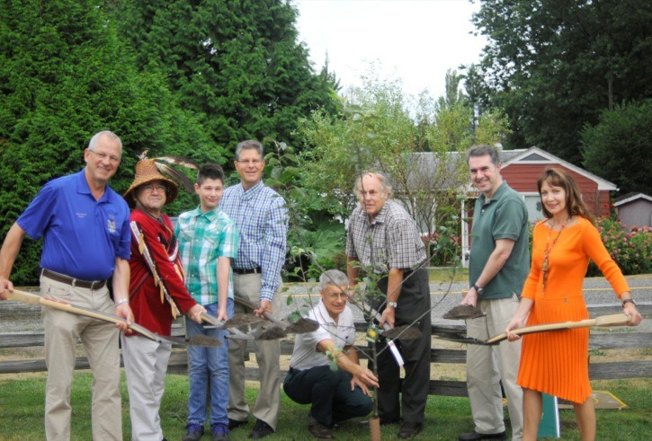 A tree planting ceremony at Fort Langley's historic orchard took place Saturday, involving Langley's 2013 Environmental Heroes. They were initially honoured at the Langley Canada Day festivities. From left to right are Langley Township Mayor Jack Froese, Kwantlen First Nation elder Lekeyten, youth environmental hero Maxime Labrecque, Langley MP Mark Warawa, Mike Starr of Fort Langley, Bob Puls of Langley Field Naturalists, the winner in the business and organizations category, Lionel Pandolfo of Langley Environmental Partners, and Susan Falk, individual environmental hero.