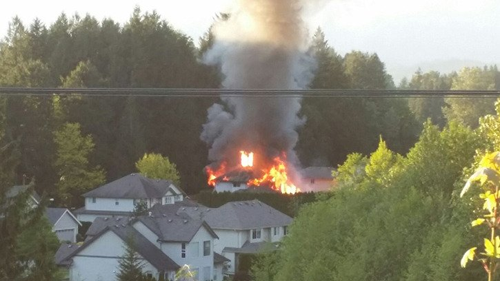 A house on Llanberis Way in Popkum goes up in flames Thursday evening.