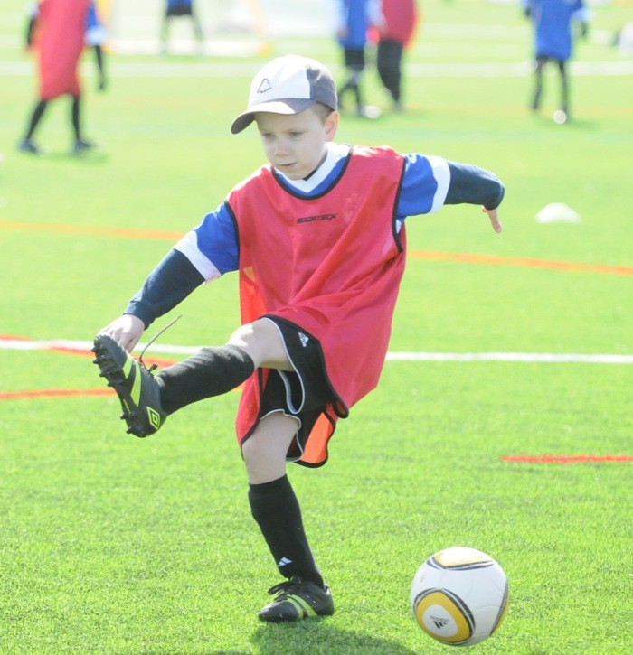 Austin winds up for a big kick during Langley United Youth Soccer Association's mini-World Cup for U5 to U7 players at Willougby Community Park on Saturday.