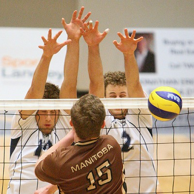 Trinity Western's Lucas Van Berkel (left) and Mikiah Schalk team up to block Manitoba's Carson Kauenhowen during Saturday night's match at the Langley Events Centre. The Spartans won both nights to edge Manitoba for third place in the Canada West standings.