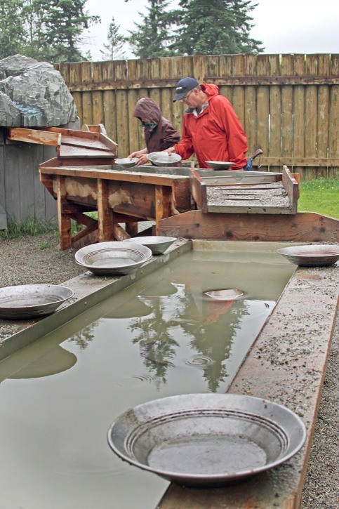 The rainy weekend weather didn't stop people from coming out to celebrate Parks Canada's 100th anniversary at the Fort Langley Historic Site on Saturday. Part of the activities included learning how to gold pan.