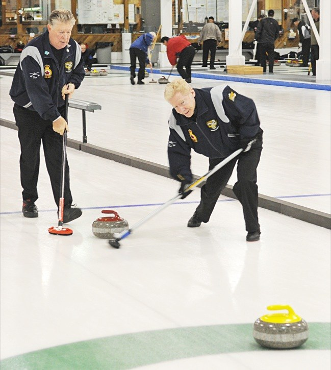 Tommy Booth (left) and Bob Fisher were among the competitors at the Langley Curling Club's men's bonspiel last week. The event featured 36 teams from around the Lower Mainland.