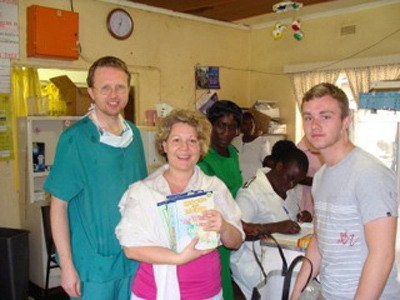 Dr. Paul Thistle (left) was abruptly fired and told to leave Zimbabwe by the leaders of the Salvation Army in the African country. Here he stands with Langley Rotarian Katy Loewen and her son who visited the hospital last year.