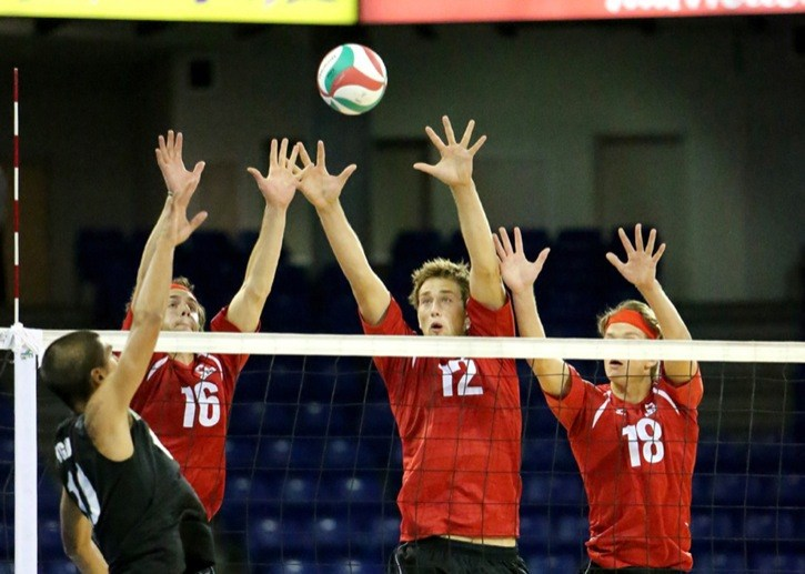 Team Canada's Derek Thiessen (left to right), Lucas Van Berkel and Nick Del Bianco go for the block against Mexico on the opening day of the U23 Pan American Volleyball Cup at the Langley Events Centre.
