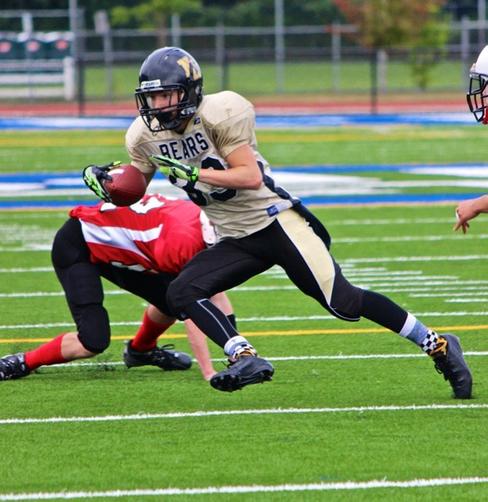 North Langley Bears running back Zander Bailey eludes a Mission Niners tackler during bantam football action at McLeod Athletic Park on Saturday afternoon. The Bears opened the Valley Community Football League season with a 28-6 victory.
