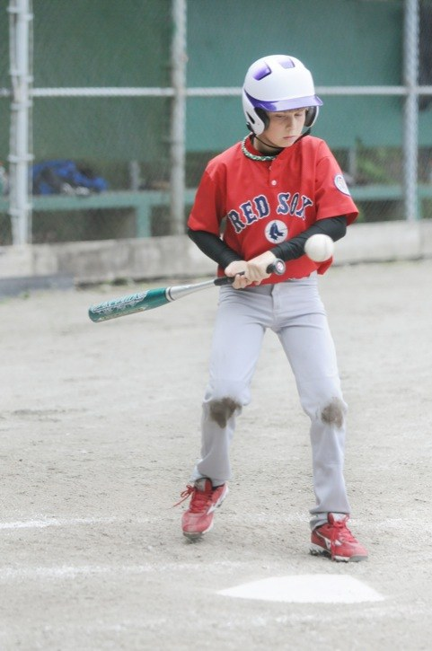 Jordan Marwood of the North Langley Red Sox sizes up a pitch during a 9/10 tier 1 baseball game against the White Rock Angels on Sunday at Walnut Grove Community Park. The Red Sox hammered the Angels 11-1.