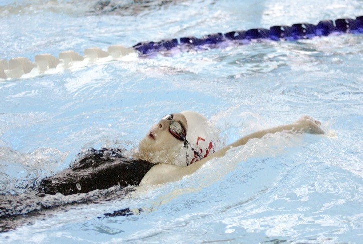 Alicia Schmelcher competes in a preliminary heat for the backstroke during the Langley Olympians Swim Club's 10th annual invitational swim meet at the Walnut Grove Aquatic Centre over the weekend.