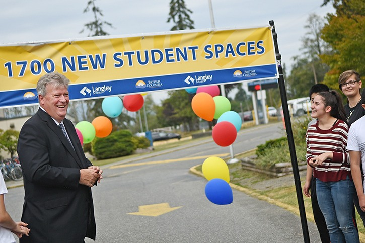 Fort Langley-Aldergrove MLA Rich Coleman and R.E. Mountain Grade 12 student Marija Danyluk were among a large group of officials, school board members, teachers and students at the Friday afternoon announcement that $67 million will be invested to create up to 1,700 new students spaces in Langley.