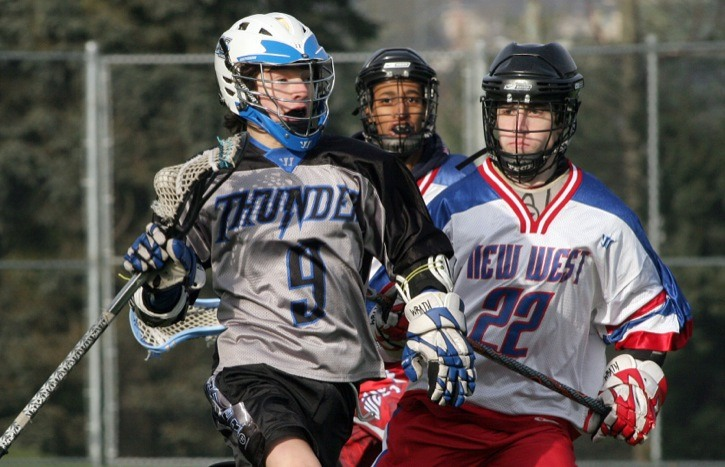 Langley Thunder forward Caleb Pearson streaks up field past New Westminster Hyacks defender Frank Darby in the first half of their Pacific Coast Lacrosse League U-14 game on Saturday at Queen's Park.