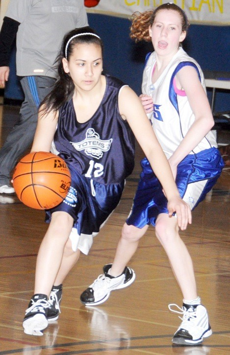 Aldergrove Totems' Terrisa Inthapanya streaks past R.E. Mountain Eagles' Paige Meister in junior girls' basketball. Aldergrove won this league game 35-21. The Langley district championships wrap up today (Thursday) at the Langley Events Centre.