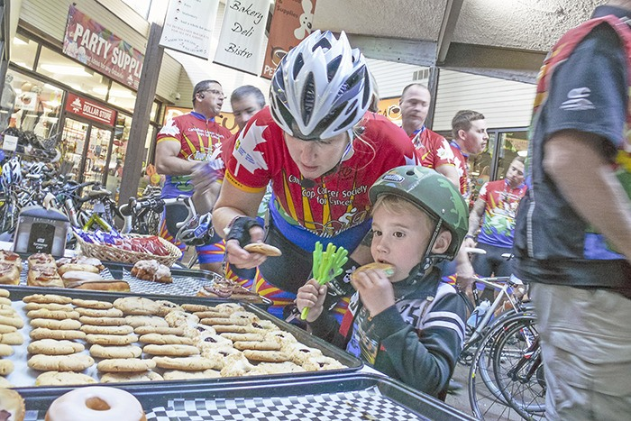 Mason, 4, eats a cookie with his mom, acting sergeant Sarah Swallow of the Delta Police department, at the Cedarbrook Bakery on 200 Street. Mason was waiting to greet his mom and the other riders on the 2015 Tour de Valley Team of Cops for Cancer as they rolled through Langley on Tuesday afternoon. The cyclists rode 800 kilometres between Sept. 24 and Oct. 2.