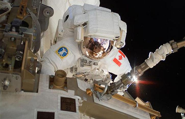 The Canadian Space Agency (CSA) Astronaut Dave Williams performs a spacewalk during Shuttle Mission in 2007.
