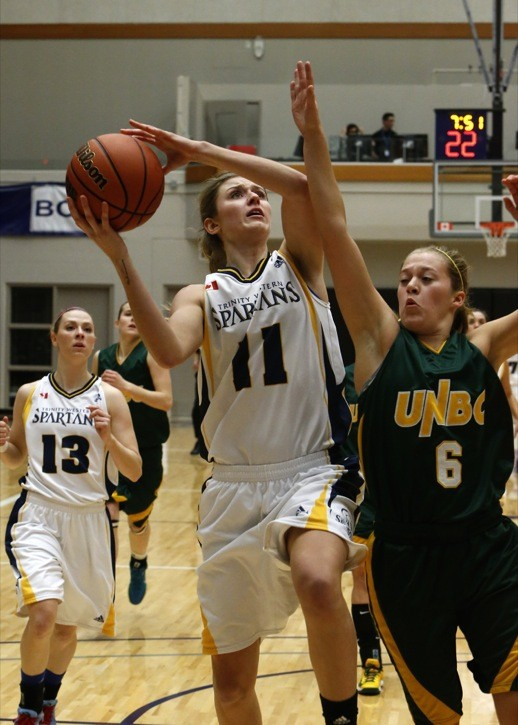 Trinity Western Spartans Holly Strom goes hard to the hoop during her team's game against the UNBC Timberwolves over the weekend at the Langley Events Centre.