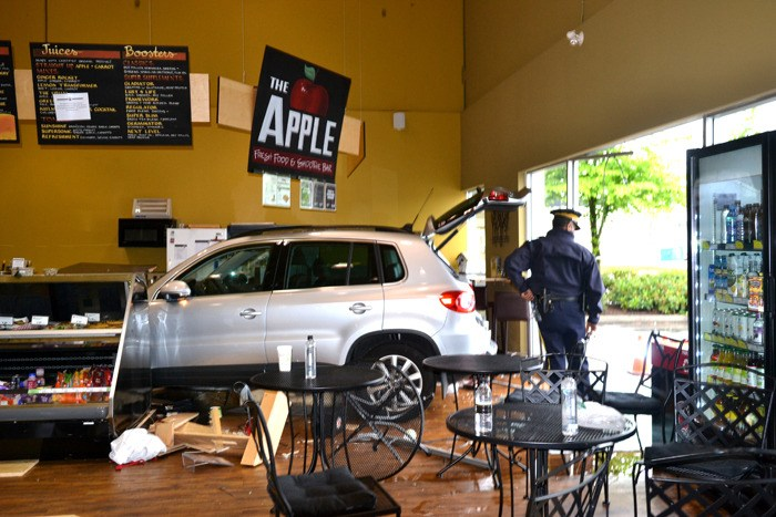 An elderly man driving this SUV appears to mistook the gas for the brake and drove into Nature Fare's bistro on Monday afternoon. The crash seriously injured two employees.