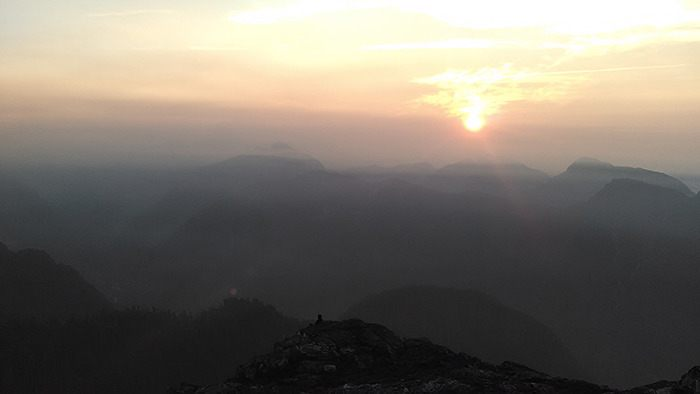 David Clements and his son watched a hazy sunrise atop the Golden Ears in August.