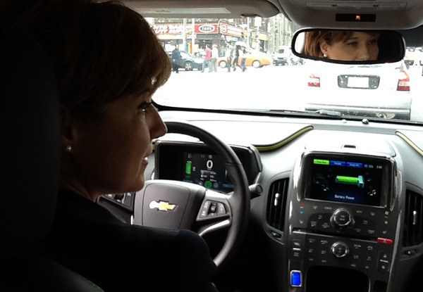 Premier Christy Clark takes a Chevy Volt electric car for a spin in downtown Toronto last week.