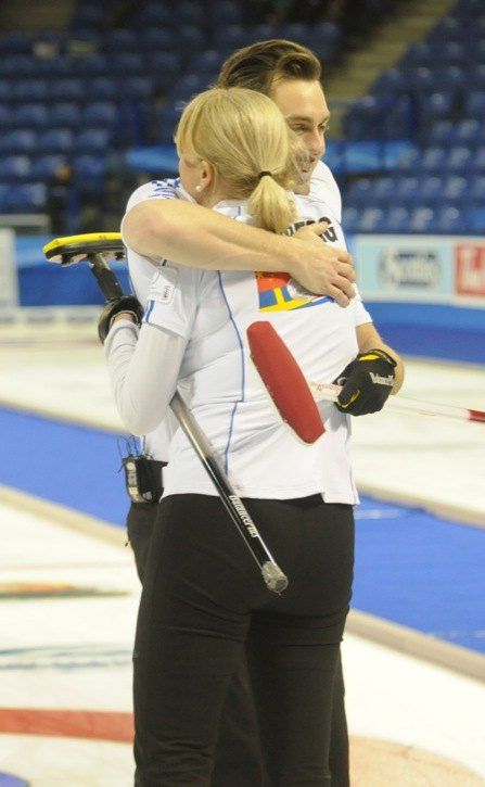 Team World's Sebastian Kraupp and Anette Norberg share a hug after defeating Team North America during mixed doubles action on day one of the Continental Cup of Curling. Kraupp and Norberg won their match against Reid Carruthers and Kim Schneider. The Continental Cup continues until Sunday at the Langley Events Centre.