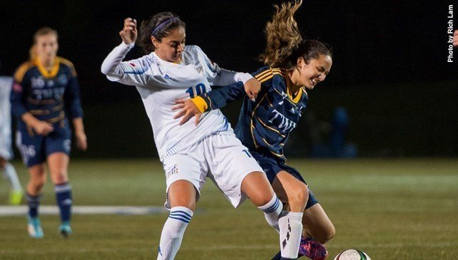 Trinity Western Spartans' Kristen Sakaki (right) and UBC's Reetu Johal battle for the ball during the Spartans 2-1 victory on Oct. 14 at UBC's Thunderbird Stadium. A pair of victories over the weekend helped the Spartans clinch top spot in the Pacific Division.
