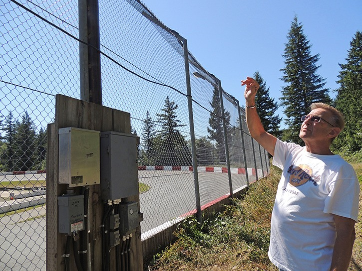 Tom Baldwin looks at the new wiring at the Agassiz Speedway, installed as high as possible following a devastating theft leaving the non-profit organization with about $10,000 in damages. Volunteers worked through the week to ensure the track would be ready for this Saturday's races, weather permitting.