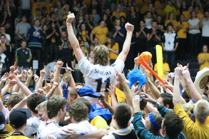 Trinity Western Spartans Rudy Verhoeff is lifted up by a mob of fans at the Langley Events Centre after the Spartans won the CIS national men's volleyball championship in March.