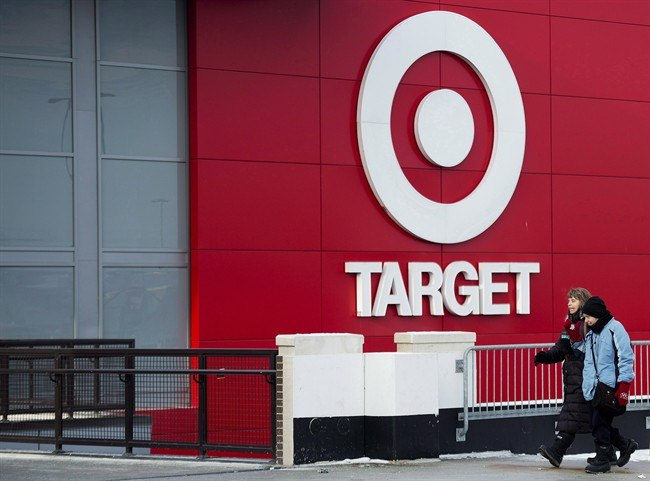 People arrive to shop at a Target store in Toronto on Thursday, January 15, 2015. Target will seek court approval this week to allow a group of liquidation companies to sell off the contents of its Canadian stores. THE CANADIAN PRESS/Nathan Denette