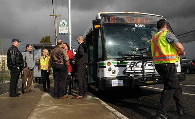 Dignitaries and representatives from BC Transit wait for the 10:15 Fraser Valley Express #66 bus to depart from Spadina Avenue in Chilliwack on Tuesday.