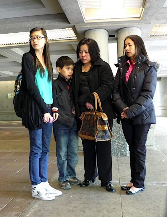 Relatives of the victims of a 2008 gas leak at a Langley mushroom farm attended Surrey Court Friday morning (May 13) to witness guilty pleas being entered by three individuals and two companies. L to R: Tracey Phan, whose father remains in a coma, Phat Trieu and his mother Nga Trieu, whose husband died trying to rescue fellow workers and Phuong Le, Tracey's mother.