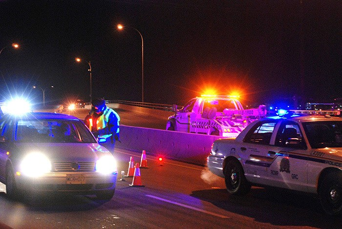 """Langley RCMP Traffic Services were out in force on Dec. 7 conducting an impaired driving Counter Attack on the Langley 204 Street overpass. """"Have a plan, and utilize the plan,"""" said Traffic Services' Sgt. Gerard Sokolowski. """"Don't drink and drive, because if you drink and drive in Langley, you're gonna get caught and we'll have to deal with you."""""""