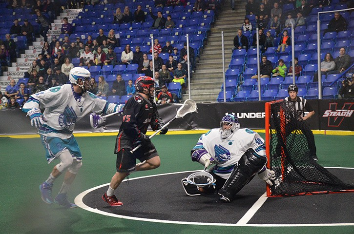 Corey Small scores one of his four goals against the Rochester Knighthawks on Feb. 25 at the Langley Events Centre. Small leads the Vancouver Stealth with 25 goals this season but the team is struggling at 3-6.