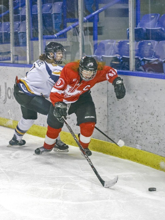 Vancouver Island Hurricanes' Elaina Drewry (right) eludes Fraser Valley Phantoms' Delaney Duchek behind the net during the final game of a four-game series between the B.C. Female AAA hockey rivals at the Langley Events Centre on Sunday. The Phantoms won all four games, prevailing 6-2, 13-0, 7-3 and 12-0.