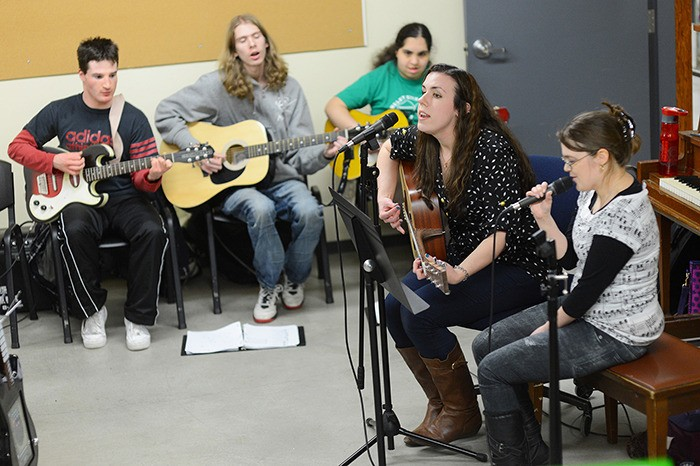 From left: Rec Rockers guitarists Andrew Kison, Isaac Vondy and Samantha Burgess, music therapist Katherine Graff and lead singer Brenna Finch.