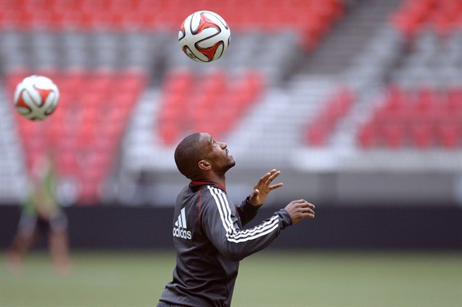 Toronto FC striker Jermain Defoe heads a ball at practice in Vancouver on Tuesday, May 13, 2014. THE CANADIAN PRESS/Jonathan Hayward