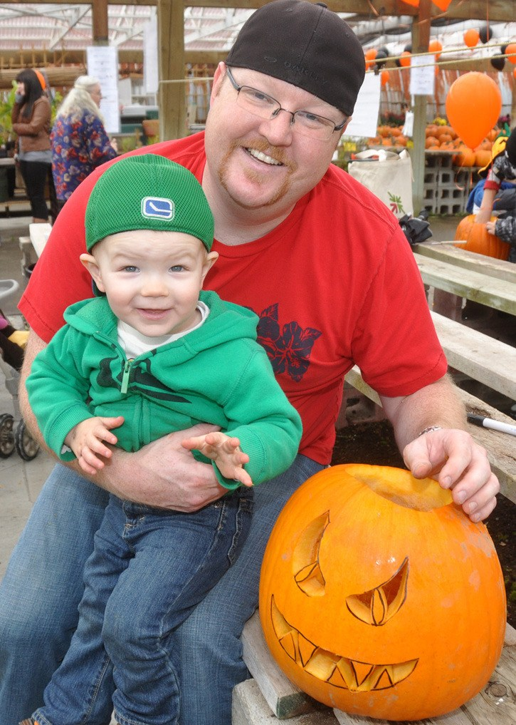 Landon Bell and his dad Scott were among the local families who carved a pumpkin for Aldergrove's first 'Wall-o-lanterns' on Saturday.