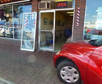 A man still gets his hair cut after an elderly man crashed his PT Cruiser into the barber shop on Monday morning.