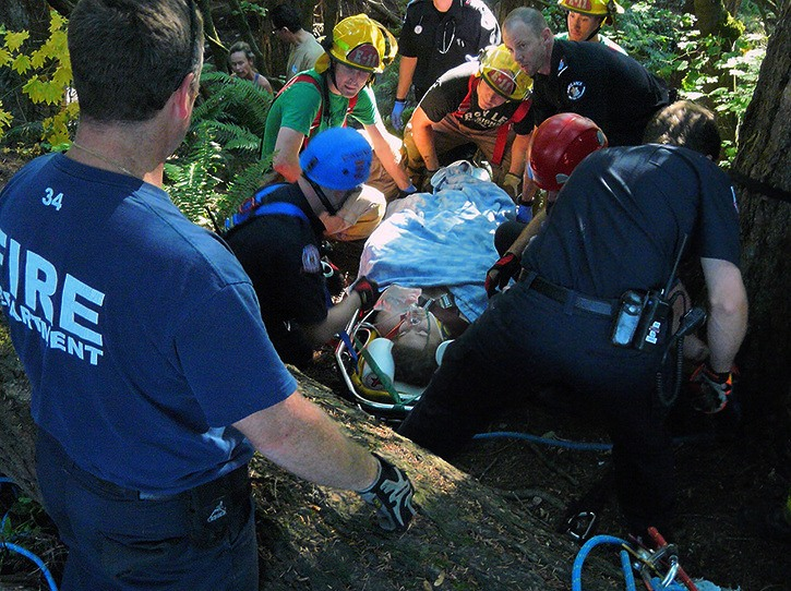 A Langley City fire rescue crew brings out a young person who fell down a ravine near 204 Street and 43 Avenue Monday afternoon.