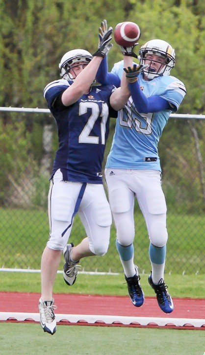 Troy Klassen (left) and Zach Middleton battle for the ball during a drill over the weekend at the Langley Rams' spring football camp at McLeod Park. Close to 100 players took part in the three-day camp as the B.C. Junior Football Conference team prepares for its first season in Langley.