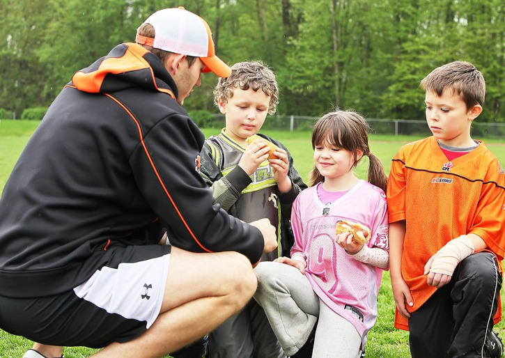B.C. Lion Doug Goldsby was a welcome participant at Langley Minor Football's skills camp. He took time to meet with young football enthusiasts Brandon Ford, Elizabeth Hawkins and Ayden Holloway. The skills camp took place on Saturday, May 14 at Walnut Grove Secondary School.