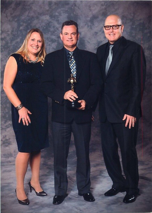 Langley's Larry Clay (centre) was named the winner of the best custom home builder at the annual Georgie Awards on Feb. 1.