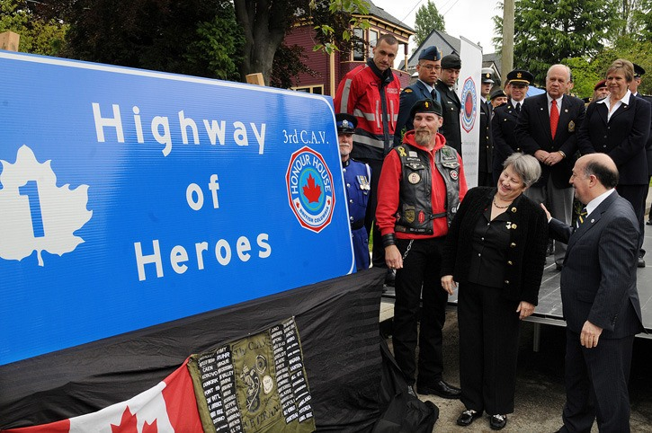 Ann Bason, the mother of Master Cpl. Colin Bason who was killed in Afghanistan, Allan De Genova, the president of Honour House and Barry Drews, of the 3rd Canadian Army Veterans, admire the mock-up of the Highway of Heroes sign that will be posted along the Trans-Canada between Langley and Abbotsford to commemorate the sacrifice of Canadian soldiers and first responders. The sign was unveiled at Honour House in New Westminster on Thursday.