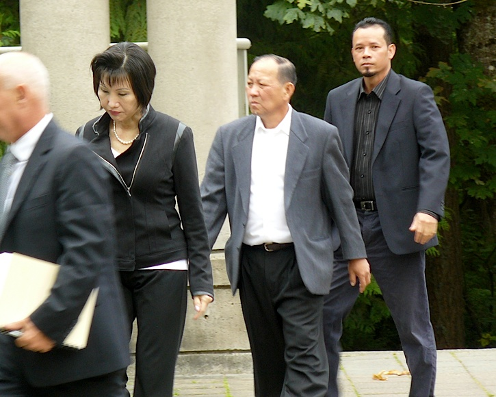 Defendants in the Langley mushroom farm tragedy arrive for their sentencing hearing in Surrey Provincial Court in Sept. 16. L to R: Van Thi Troung, her husband Ha Qua Truong and Thinh Huu Doan.