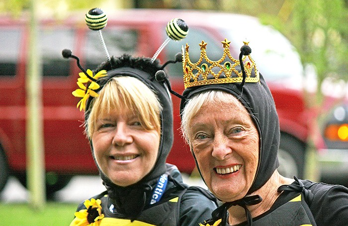 """Kathy Fraser, left, and """"Queen Bee"""" Marilyn Murphy of Langley, right, were among the costumed runners who participated in the Campbell Valley Wine Run 14K event on Sunday, Sept. 22."""