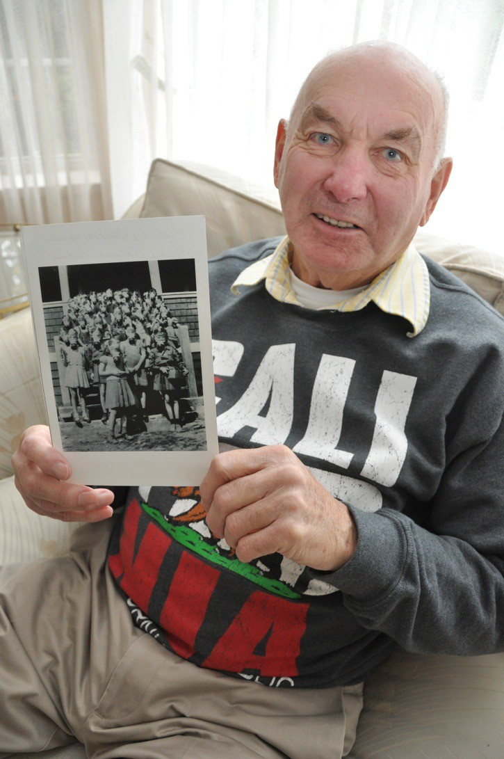 Fred van Aggelen is holding a picture he took of six graders learning how to fasten gas masks in case of an enemy attack in 1943 at his West Vancouver school. He remembers running to an assigned parent's house near his school in West Vancouver when the air raid sirens went off in the early '40s. His home was two miles away and too far to run to in f the enemy attacked.