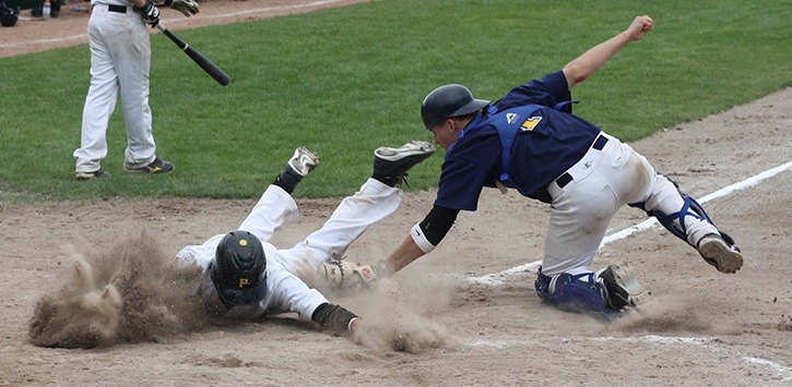 Nanaimo Palladian Pirates baserunner Aaron Page is tagged out at home plate by Langley Blaze catcher Brendan Holstrom during tournament action Monday at Nanaimo's Serauxmen Stadium. The junior Pirates won the game 5-4 in extra innings to win the Victoria Day weekend tourney.