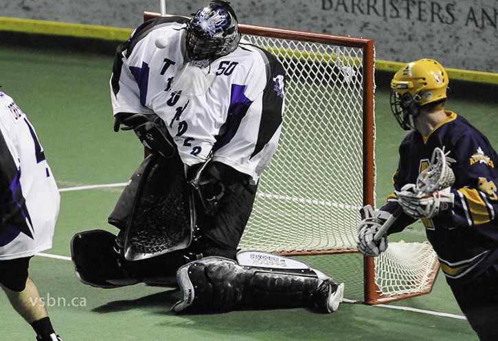 Langley Thunder goaltender Brodie MacDonald makes one of his 27 saves during his team's 5-3 victory over the Coquitlam Adanacs at the Langley Events Centre on May 22.