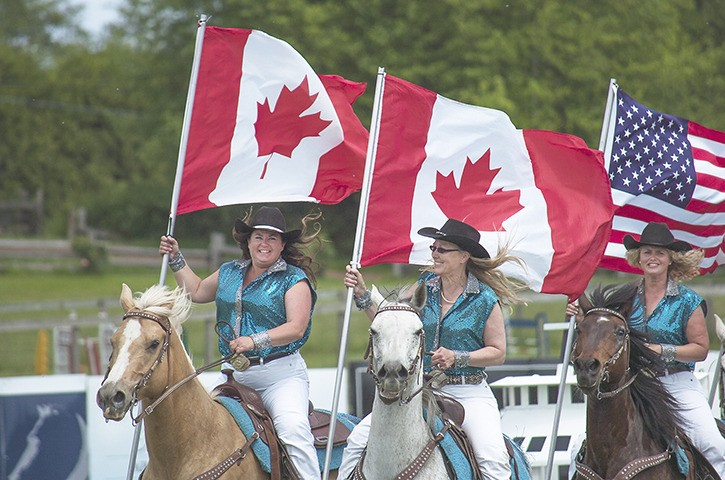 The 10th annual Grand Prix horse jumping competition and Langley School District fundraiser at Thunderbird Show Park opened with a precision riding demonstration.