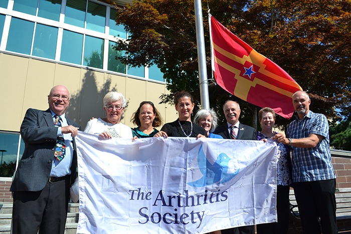 September is Arthritis Awareness Month across the country, and to kick it off in Langley, the City of Langley raised the Arthritis Society flag in front of City Hall on Sept. 4. From left: Councillor Jack Arnold; Councillor Gayle Martin; Trish Silvester-Lee - manager, Education & Services - Fraser Region, The Arthritis Society, BC & Yukon Division; Councillor Rosemary Wallace; Joan Vyner, Director Education & Services; Mayor Ted Schaffer Cheryl Young, Founder and Executive Director, Fibromyalgia Wellspring Foundation; Drew McArthur, National Board Chair, The Arthritis Society. A similar ceremony was held at the Township of Langley civic centre the same day.