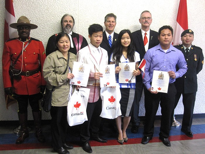 From left: RCMP R.Const. Aubrey Bacchus, Justice Minor, Township Councillor Charlie Fox, MP Mark Warawa, and Master Corporal Andrew Tan with new Canadian citizens